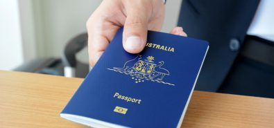 Hands giving passport