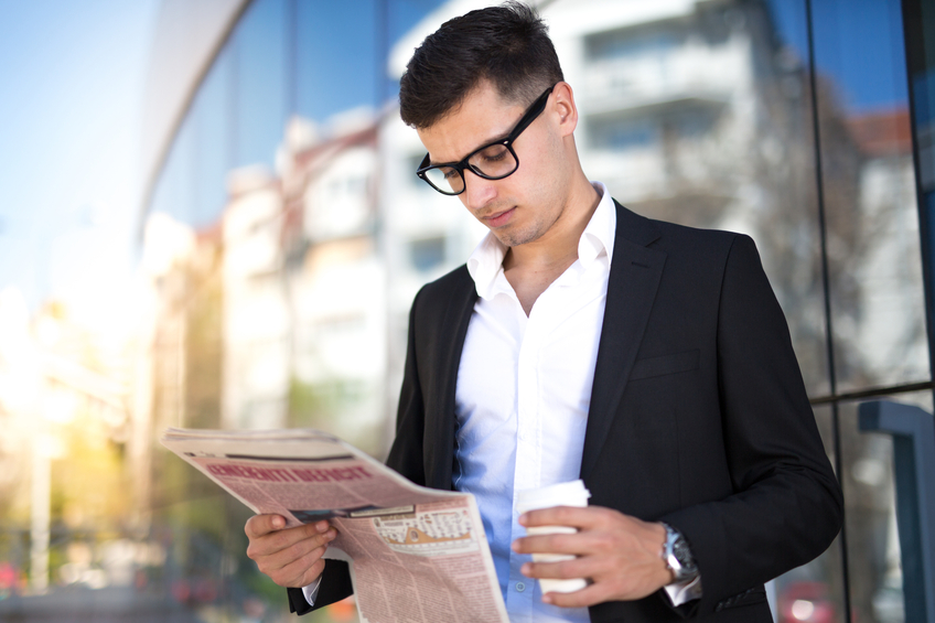 Business Man With Coffee and Newspaper