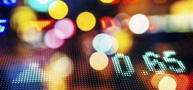 stock market numbers with Blurred city lights